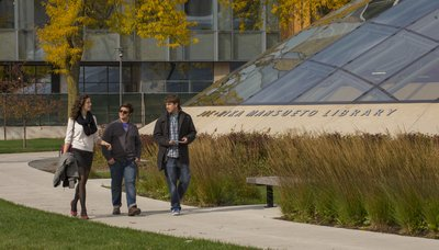 Students walk along the Mansueto Library exterior
