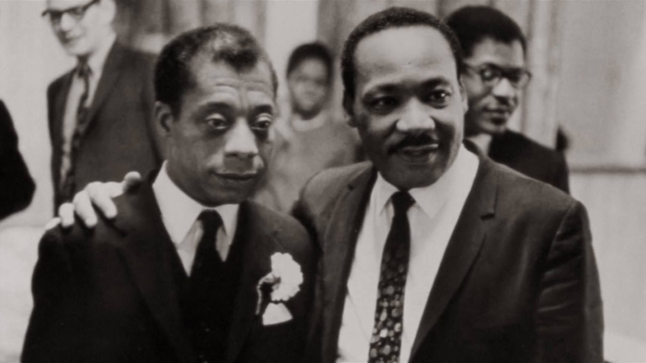 Baldwin standing with MLK's arm around him