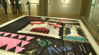 The UChicago square of the AIDS Quilt on display in the Special Collections Exhibition Gallery