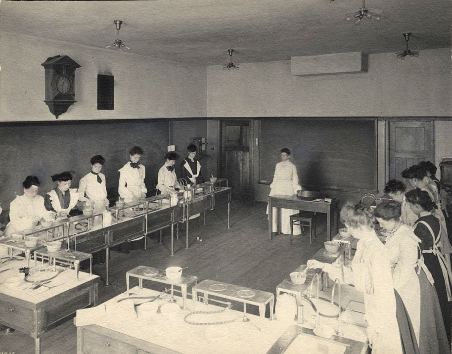 Group of women working on lab equipment