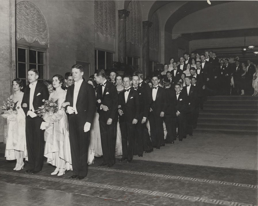 Line of couples waiting to enter the dance