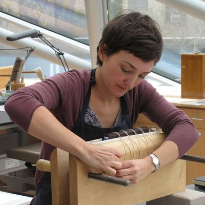 Conservationist repairing a damaged rare book
