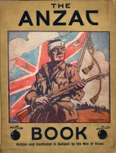 Soldier in front of flag on cover of the Anzac Book