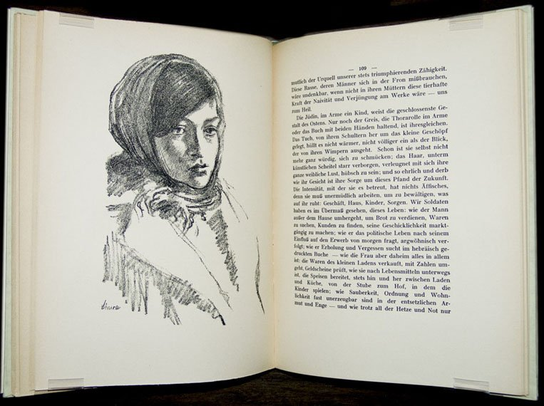 An open book with the illustration of a young, beautiful woman with a head covering.