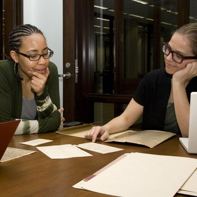Researchers looking over archival materials