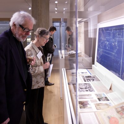 Library patrons looking at exhibition items in the Special Collections gallery