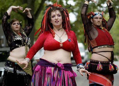 Dancers from Different Drummer Bellydance troupe perform at a street festival in Bloomington, IN.  (Photo by Adam Zolkover.)
