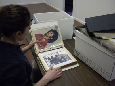 A woman looks at a photo album