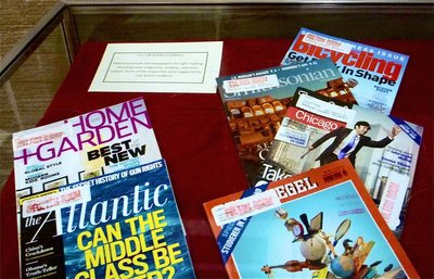 Photo of D'Angelo Law Library exhibit displaying selected Fulton Room magazines