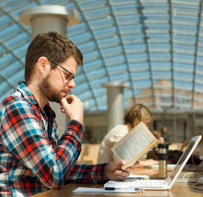 Patron researching in Mansueto Library's Grand Reading Room