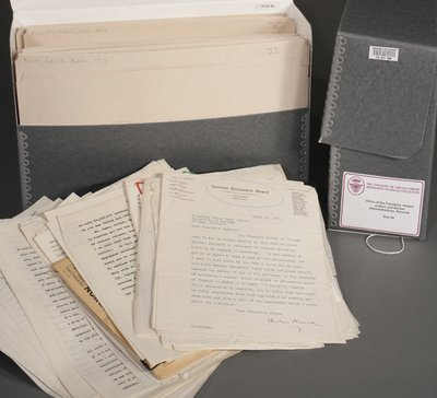 Archival boxes with documentation shown inside