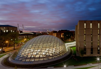 Exterior view of Mansueto Library at dusk