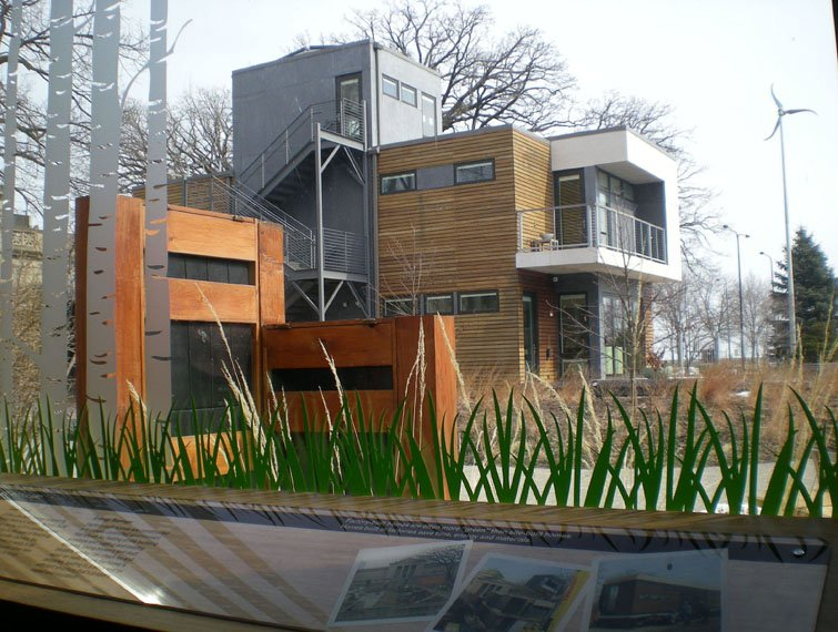 A cubist, modern-looking house made of metal and wood.