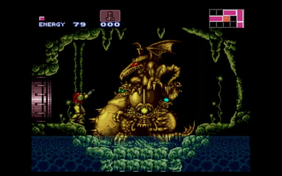 "Screen capture of a large golden statue representing the ""boss"" of the game"