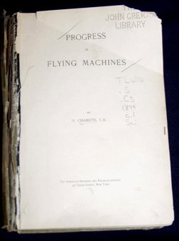 "A photograph of a battered book entitled ""Progress in Flying Machines."""