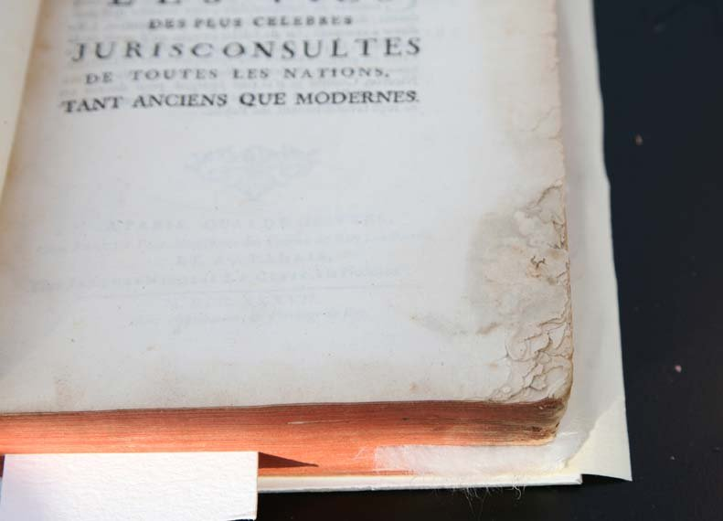 Close-up of molded corner on pages within an 18th century book.