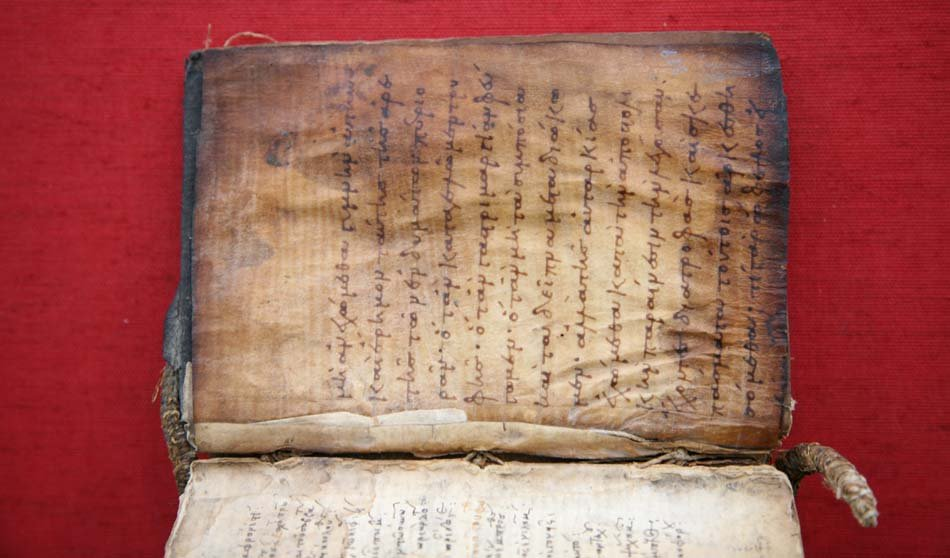 Inside pages of book showing charred marks and wrinkles