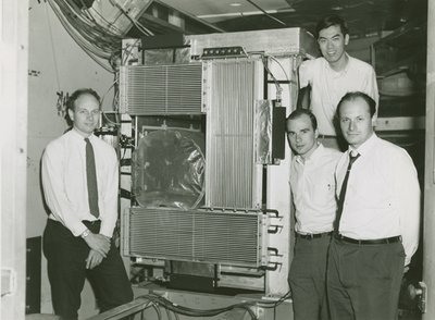 James Cronin (left) with apparatus and colleagues