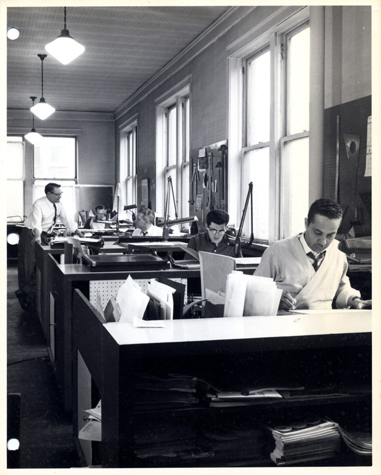 Eugene Winslow working at his desk