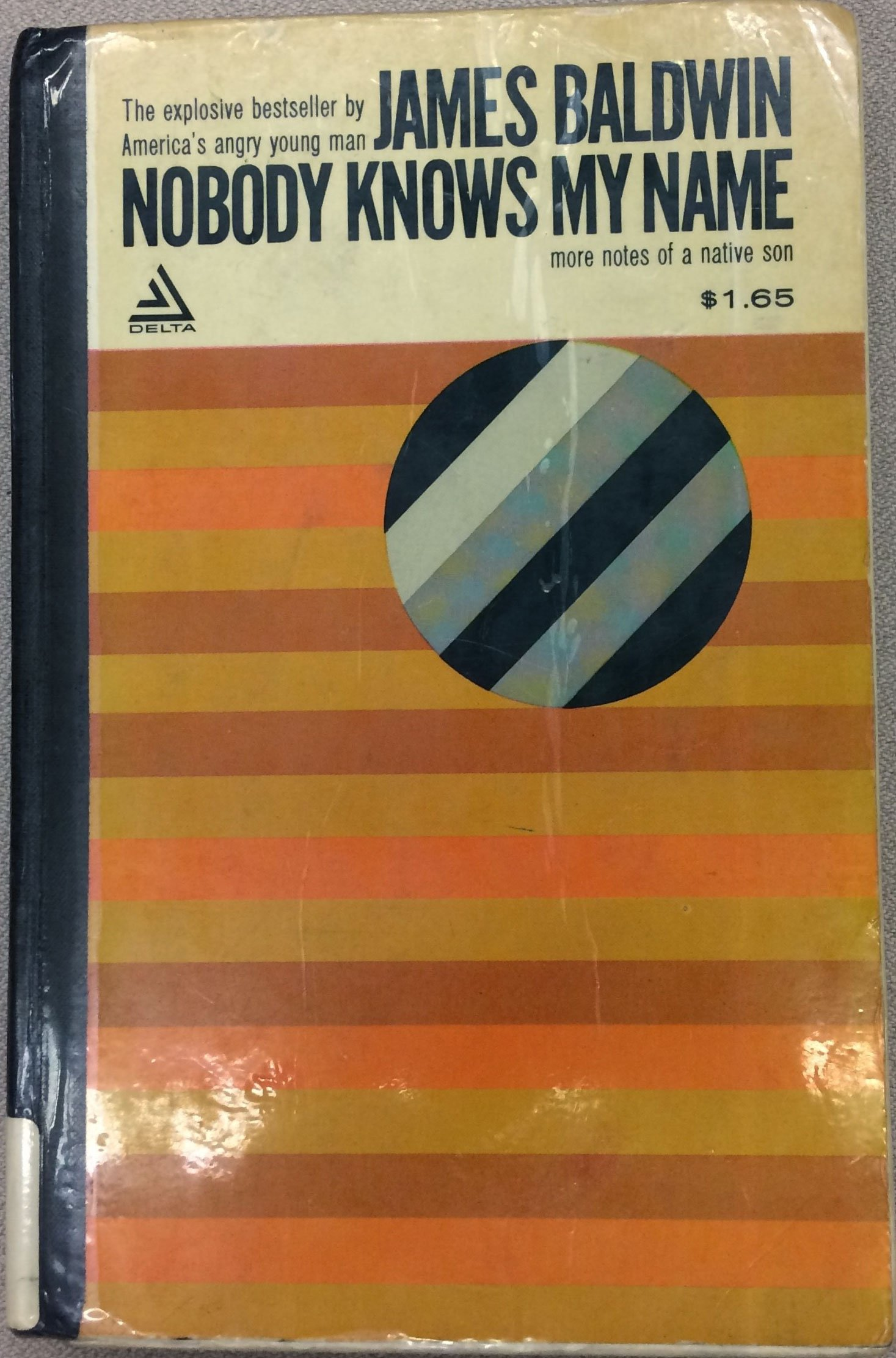 A book's front cover depicting a tilted black-striped circle contrasting with the background's horizontal red stripes.